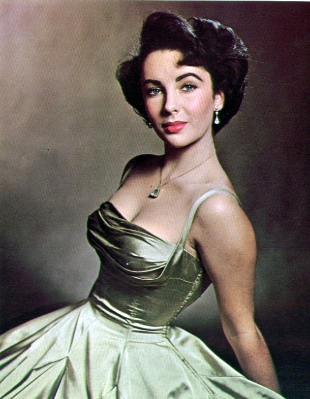 sassyisconvienent.Elizabeth Taylor almost 17 sits for photographer Phillippe Halsman in a decollete evening dress of gold silk 610x786 FASHION ICON: Elizabeth Taylor